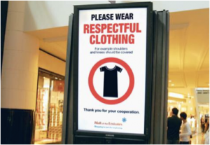 """""""Please wear respectful clothing"""" sign"""